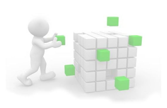 3D-графика с изображением человека бережно собирающего большой куб из малых частей